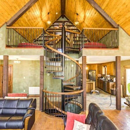 multi story rustic living room spiral stair
