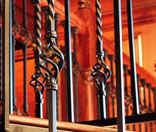 twisted cage balusters forged iron spiral stair