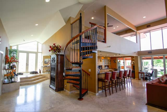 forged iron spiral stair with solid wood steps and handrail