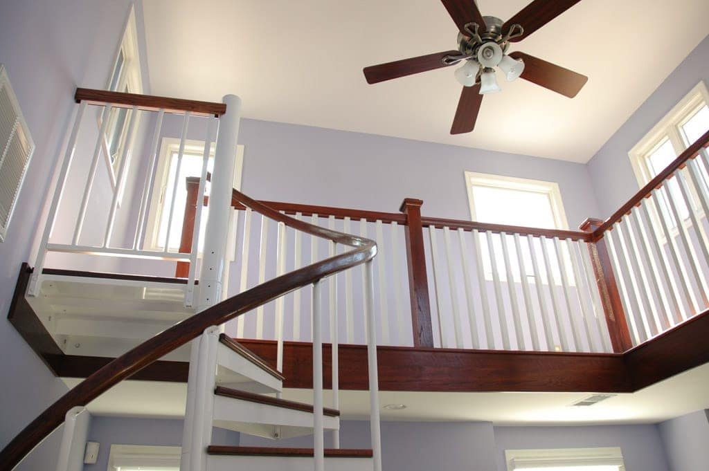matching loft railing with wood handrail