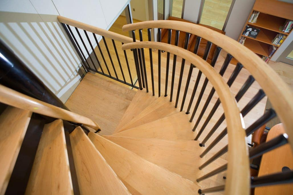 custom office steel spiral stair with wood treads