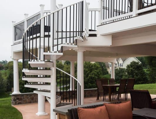 outdoor spiral stair with matching deck railing