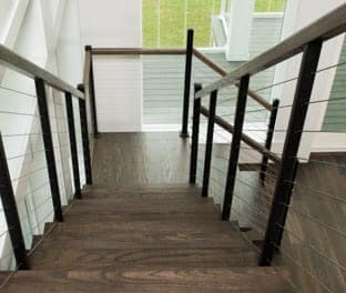 floating stair with cable railing and wood steps