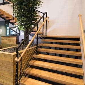 metal straight staircase with wooden accents
