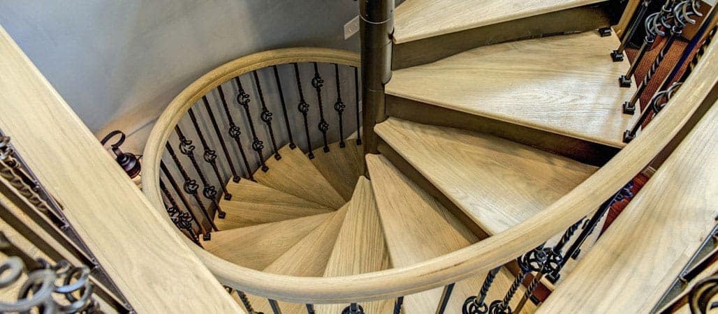 Forged Iron Spiral Staircase With Wood Accents